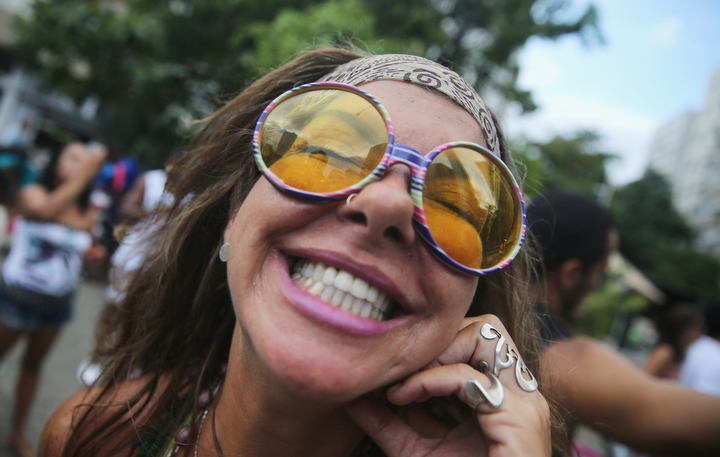 A reveler smiles while posing during a 'bloco' street parade during pre-Carnival festivities in Rio de Janeiro, Brazil. Carnival officially starts February 13 but pre-Carnival festivities are already underway in Brazil. (Mario Tama/Getty Images)