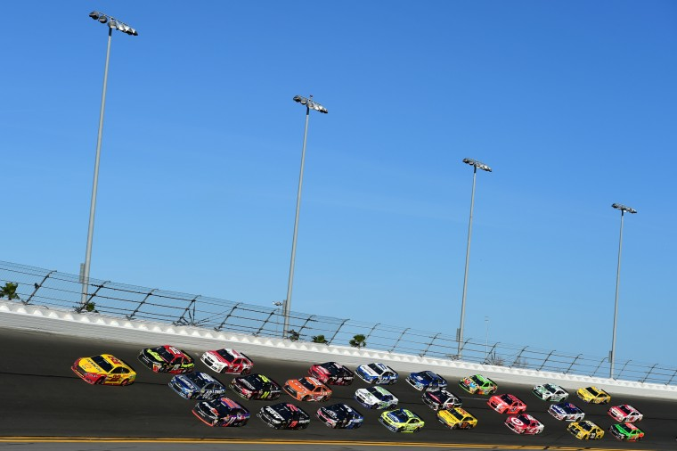 Joey Logano, driver of the #22 Shell Pennzoil Ford, leads the field during the NASCAR Sprint Cup Series 57th Annual Daytona 500 at Daytona International Speedway in Daytona Beach, Florida. (Robert Laberge/Getty Images North America)