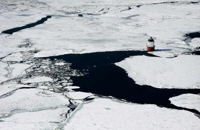 The Point No Point lighthouse surrounded by ice on the Chesapeake Bay. (Lloyd Fox/Baltimore Sun)