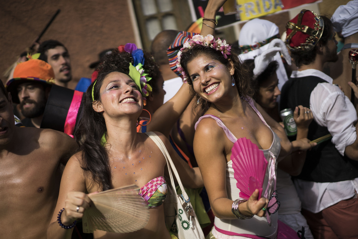 "Revelers dance during the 'Ceu na Terra', or Heaven on earth, carnival parade in Rio de Janeiro Brazil. Rio's over-the-top Carnival is the highlight of the year for many local residents. Hundreds of thousands of merrymakers are beginning to take to the streets in open-air ""blocos"" parties. (Felipe Dana/Associated Press)"