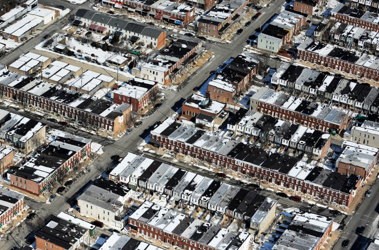 A view from the air of rowhouses in East Baltimore. (Lloyd Fox/Baltimore Sun)