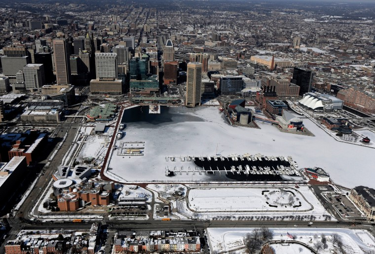 Baltimore sprawls around the mostly frozen Inner Harbor.(Lloyd Fox/Baltimore Sun)