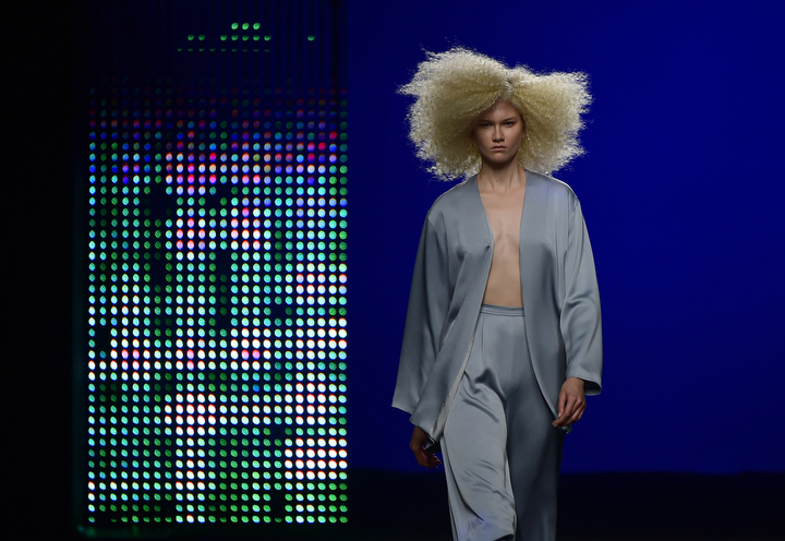 A model presents a creation by Spanish designer Duyos during the Autumn-Winter 2015-2016 collection fashion show during the Mercedes Benz Madrid Fashion Week. (Pierre-Philippe Marcou/AFP-Getty Images)