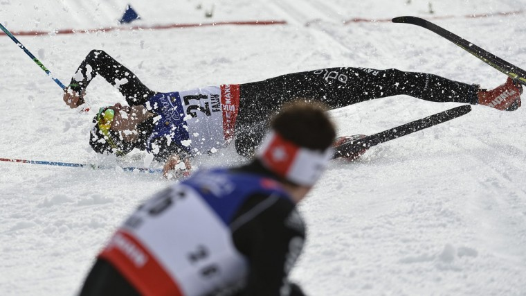 Switzerland's Uli Schnider, top. and Jovian Hediger are seen at the finish line the men's Sprint Qualification at the Nordic Skiing World Championships in Falun, Sweden, Thursday, Feb. 19, 2015. (AP Photo/Anders Wiklund, TT)