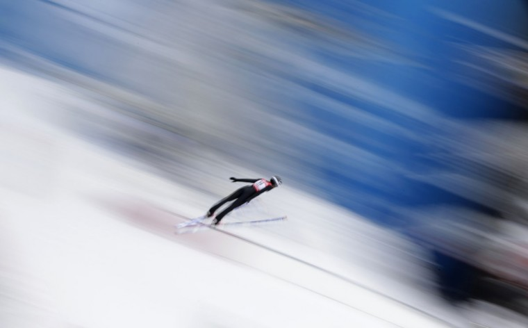 In this photo taken with slow shutter speed Italy's Evelyn Insam makes an attempt during a training session for the women's ski jumping at the Nordic Skiing World Championships in Falun, Sweden, Wednesday, Feb. 18, 2015. (AP Photo/Matthias Schrader)