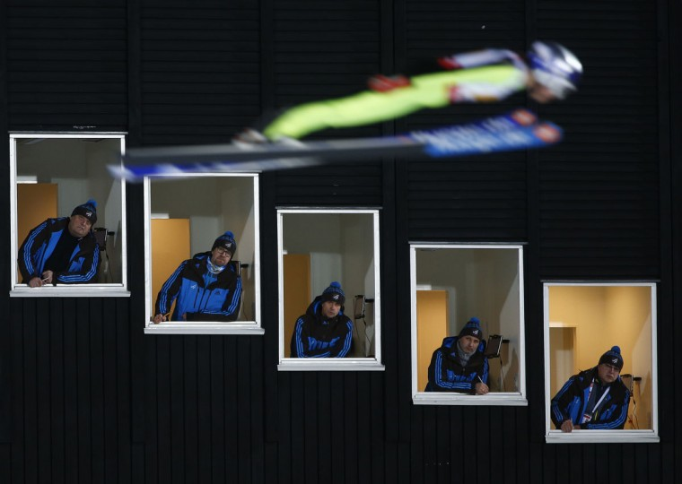 United States' Sarah Hendrickson jumps and is pictured with a longtime shutterspeed as judges look out of their tower windows during the Mixed Team Ski Jumping competition at the Nordic Skiing World Championships in Falun, Sweden, Sunday, Feb. 22, 2015. (AP Photo/Matthias Schrader)