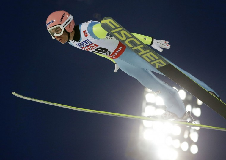 Austria's Stefan Kraft soars through the air the mens' normal hill skijumping at the Nordic Skiing World Championships in Falun, Sweden, Saturday, Feb. 21, 2015. (AP Photo/Matthias Schrader)