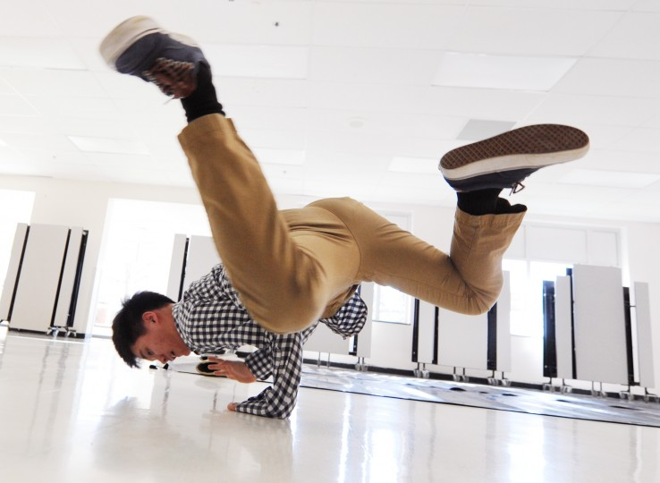 John Oh, 16, a junior and co-captain of the Mt. Hebron Break Dance team, practices a spinning move in the school cafeteria, Tuesday, Feb. 3, 2015. (Jon Sham/BSMG)