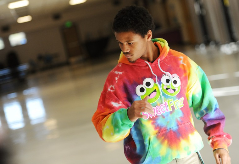 Mt. Hebron senior break dancer Khalif Green, 17, shows off his moves during a team practice, Tuesday, Feb. 3, 2015 in the school cafeteria. (Jon Sham/BSMG)