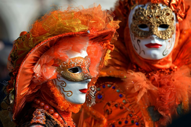 Costumed revelers poses on St Mark's square during the Venice Carnival on February 8, 2015 in Venice. (VINCENZO PINTO/AFP/Getty Images)