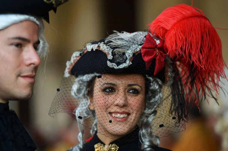 Costumed revelers pose on St Mark's square during the Venice Carnival on February 8, 2015 in Venice. (VINCENZO PINTO/AFP/Getty Images)