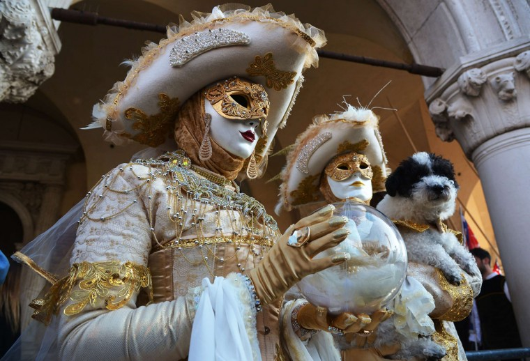 Costumed revelers pose at St Mark's square during the Venice Carnival on February 8, 2015 in Venice. (VINCENZO PINTO/AFP/Getty Images)