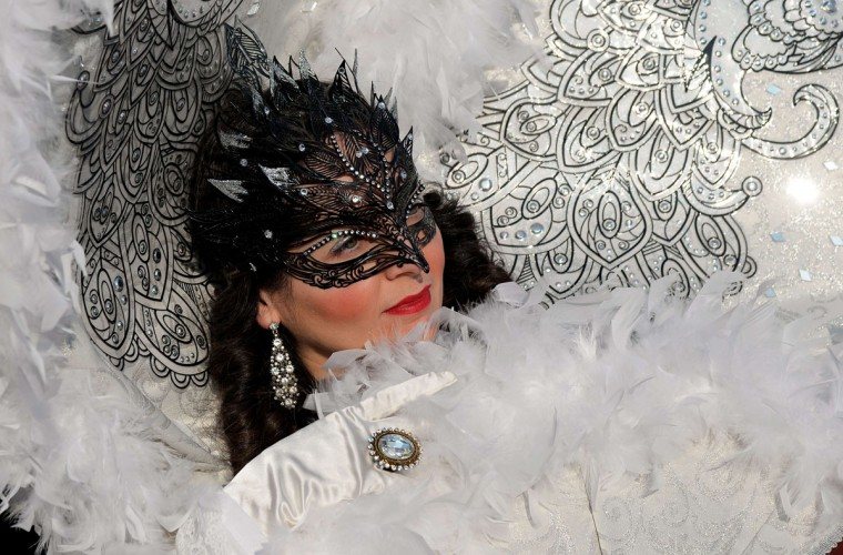 "A costumed reveler poses at St Mark's square (Piazza San marco) during the Venice Carnival on February 8, 2015 in Venice. The 2015 edition of the Venice carnival is ""The world's most delicious festival"" and runs until February 17th. (VINCENZO PINTO/AFP/Getty Images)"