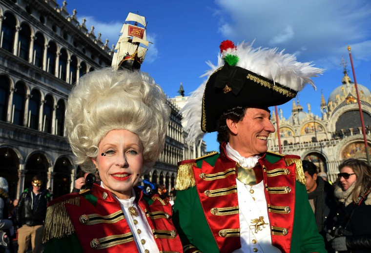 Costumed revelers pose on St Mark's square during the carnival on February 7, 2015 in Venice. (VINCENZO PINTO/AFP/Getty Images)