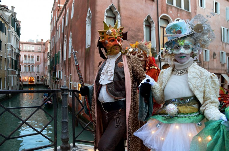 Costumed revelers arrive in St Mark's square during the carnival on February 7, 2015 in Venice. (VINCENZO PINTO/AFP/Getty Images)