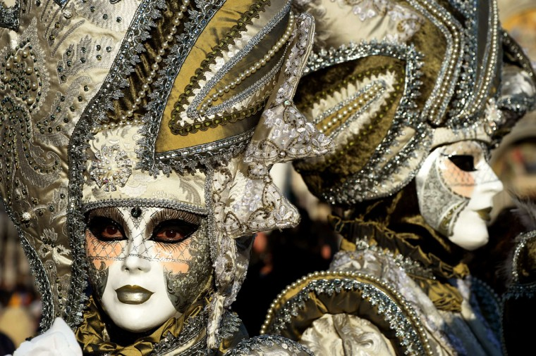 A costumed reveler poses in St Mark's square during the carnival on February 7, 2015 in Venice. (VINCENZO PINTO/AFP/Getty Images)