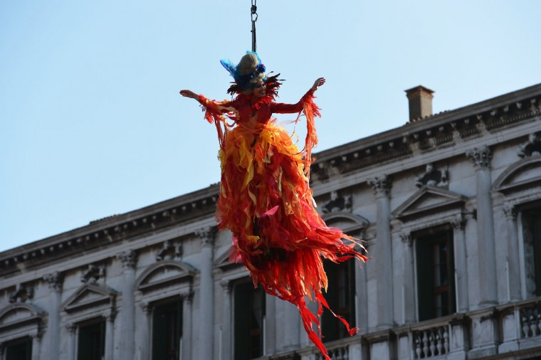 "Marianna Sereni performs the ""Angel flight"" or ""Flight of the dove"" from the bell tower of St Mark's square (Piazza San Marco) to officially launch the Venice Carnival on February 8, 2015 in Venice.(VINCENZO PINTO/AFP/Getty Images)"