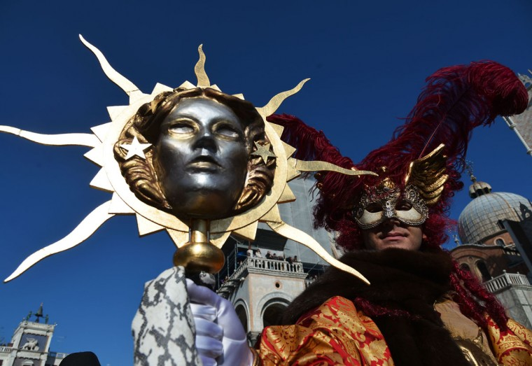 A costumed reveler poses on St Mark's square during the Venice Carnival on February 8, 2015 in Venice. (VINCENZO PINTO/AFP/Getty Images)