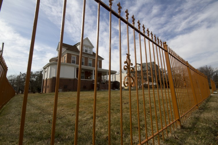 Signs of rehabilitation crop up around the neighborhood with new construction on older lots, or with older vacant homes being bought and rehabilitated. Here, a rehabilitated home sits behind a fence. (Kalani Gordon, Baltimore Sun, Feb. 2015)