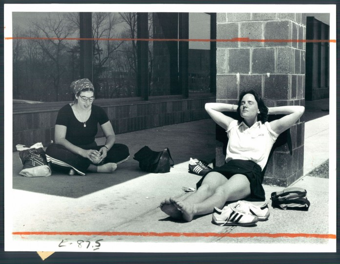 March 31, 1977: With an early-spring heat wave in progress, Charlene Diamond and Sue Hill took up different positions during an outdoor lunch break at Towson State.