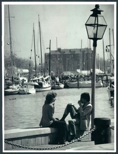 Roger Dix and Miss Pat Tenaglia both of Bolton Hill in Baltimore enjoy lunch in the sun at the Annapolis City Dock 1977.