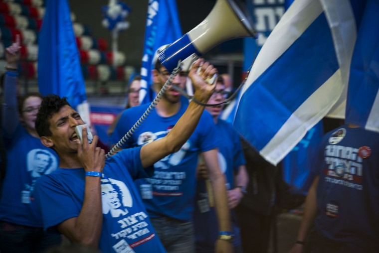 Supporters of the Zionist Union party react to preliminary election results on March 17, 2015 in Tel Aviv, Israel. The preliminary announcement of the Israeli elections brings the leading party of Benjamin Netanyahu and Zionist Union to a tie. (Photo by Ilia Yefimovich/Getty Images)