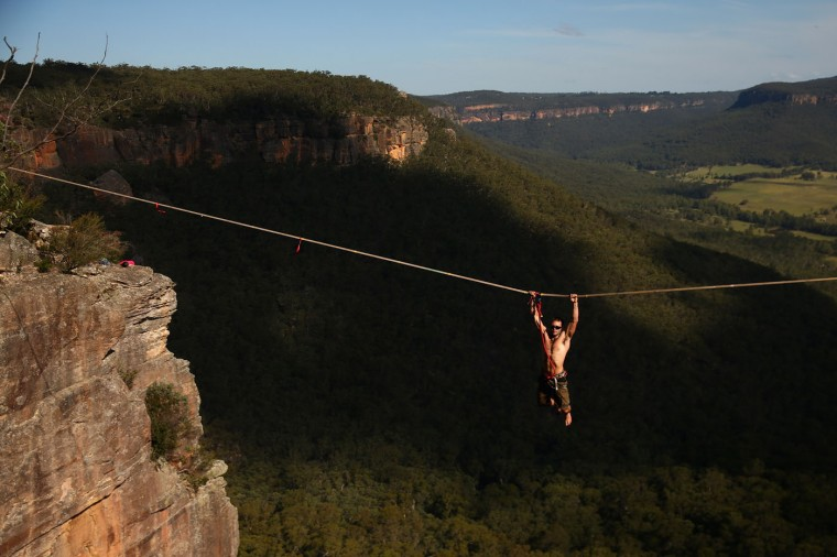 Tim Desmond of Australia hangs from a highline after falling at Corroboree Walls in Mount Victoria on March 8, 2015 in the Blue Mountains, Australia. (Photo by Cameron Spencer/Getty Images)