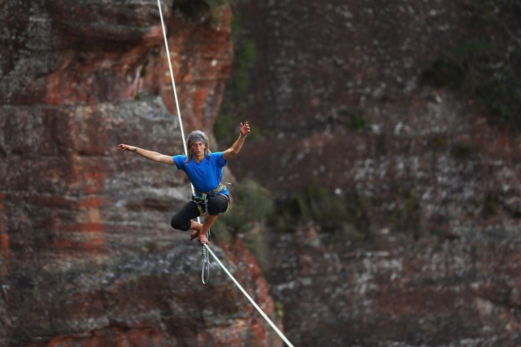Joseph Huard of Canada balances on a 90m highline rigged between cliffs at Corroboree Walls in Mount Victoria on March 8, 2015 in the Blue Mountains, Australia. (Photo by Cameron Spencer/Getty Images)
