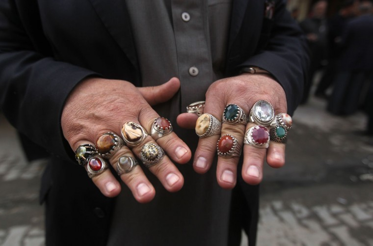 An Iraqi man displays rings for sale at an antiques market in the capital Baghdad on February 17, 2015. (Ahmad Al-Rubaye/AFP/Getty Imgeas)