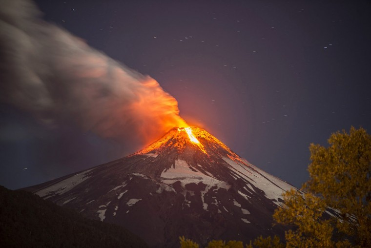 View of the Volcano Villarrica in southern Chile which began erupting on March 03, 2015 forcing the evacuation of some 3,000 people in nearby villages, the government said. The Villarrica volcano, one of Chile's most active, began erupting around 3:00 am (0600 GMT), prompting authorities to declare a red alert and cancel classes in schools, the National Emergency Office said. (Francisco Negroni/AFP/Getty Images)