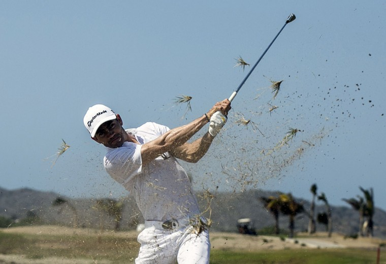 Colombian professional golf player Camilo Villegas plays during an exhibition at the Karibana Golf Resort in Cartagena, Colombia on March 3, 2015. The Karibana Beach Resort will host a Web.com Golf Championship from March 3 to 8. (Joaquin Sarmiento/AFP/Getty Images)
