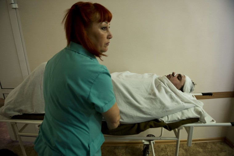 A miner wounded in a blast at the Zasyadko mine is moved for treatment at the Republican Center for Traumatology hospital in Donetsk on March 4, 2015. (John Macdougall/AFP/Getty Images)