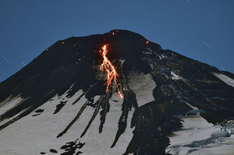 The Villarrica volcano, near Villarrica in southern Chile, shows some activity on March 4, 2015 a day after it erupted. The Villarrica erupted early Tuesday, spewing fiery plumes of lava into the night sky and forcing the evacuation of almost 4,000 people in nearby towns. In its first major eruption in 15 years, the Villarrica volcano, prompted authorities to declare a red alert, the National Emergency Office said. (Martin Bernetti/AFP/Getty Images)