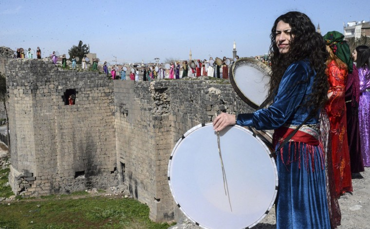 Kurdish women play instruments at the Diyarbakir historical castle to mark International Women's Day on March 8, 2015. (lyas Akengin/AFP/Getty Images)