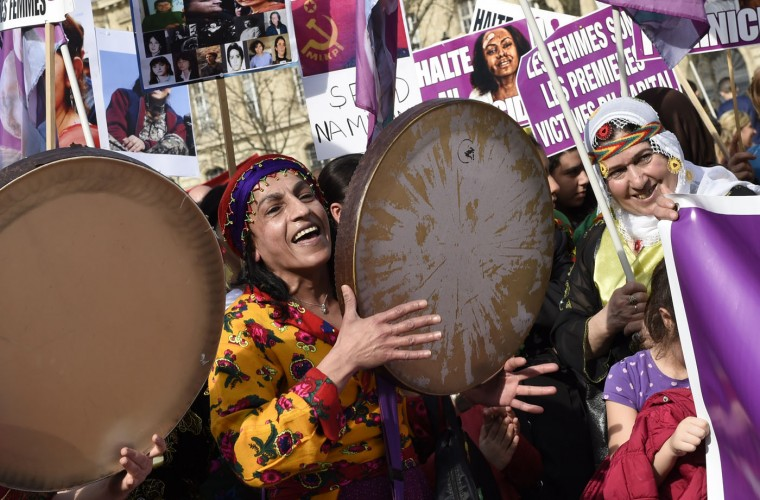 Kurdish women sing and play music as they take part in a parade marking International Women's Day in Paris on March 8, 2015. (Loic Venance/AFP/Getty Images)
