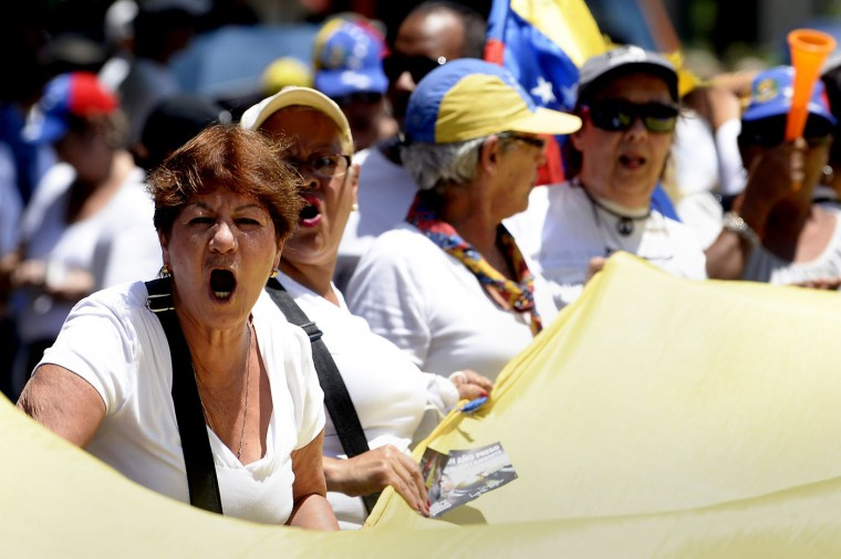 Opponents of the government of Venezuelan President Nicolas Maduro march in Caracas to mark International Women's Day on March 8, 2015. Late president Hugo Chavez's hand-picked successor, Maduro, is struggling to revive the recession-hit economy and address chronic shortages of basic goods. Maduro has taken a harder line than Chavez, jailing opponents and allowing the security forces to use deadly force to control public demonstrations. His approval rating is now hovering around 20 percent, putting the Chavistas at risk of losing key legislative elections later this year. (Federicco Parra/AFP/Getty Images)