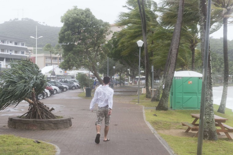 A man walks near the sea on March 14, 2015 in the Anse Vata, south of Noumea, New Caledonia. Rain and wind were observed in the island but the Tropical Cyclone Pam had little effect on Noumea. The maximum category five cyclone hit Vanuatu island, 500 km east of New Caledonia, late on March 13 and early indications suggest widespread damage, including in the capital in Port Vila, with fears dozens of people could have died across the country. (Fred Payet/AFP/Getty Images)