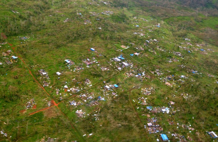 """This handout photo taken and received on March 15, 2015 by CARE Australia shows an aerial photo of damage caused by Cyclone Pam on the outskirts of the Vanuatu capital of Port Vila. Cyclone-devastated Vanuatu declared a state of emergency on March 15 as relief agencies scrambled to get help to the remote Pacific nation amid reports entire villages were """"blown away"""" when the monster storm swept through. (Tom Perry/Care/AFP/Getty Images)"""