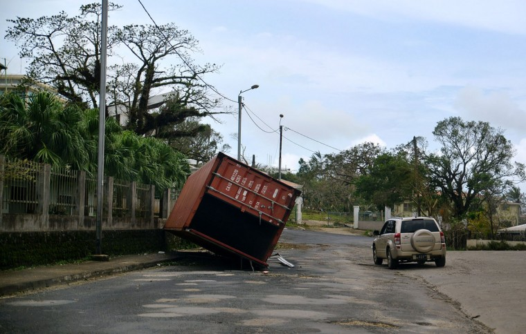 """This handout photo taken and received on March 15, 2015 by CARE Australia shows a shipping container on its side, caused by Cyclone Pam, in the centre of the Vanuatu capital of Port Vila. Cyclone-devastated Vanuatu declared a state of emergency on March 15 as relief agencies scrambled to get help to the remote Pacific nation amid reports entire villages were """"blown away"""" when the monster storm swept through. (Tom Perry/Care/AFP/Getty Images)"""