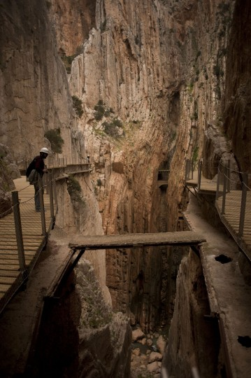 "A journalist admires the scenery during a visit to the foot-path ""El Caminito del Rey"" (King's little path), a narrow walkway hanging and carved on the steep walls of a defile in Ardales near Malaga on March 15, 2015. (Jorge Guerrero/AFP/Getty Images)"