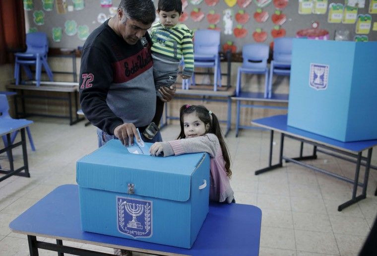 An Arab Israeli man casts his ballot at a polling station in the northern Israeli town of Umm al-Fahm on March 17, 2015. Voting polls opened for unpredictable elections to determine whether Israelis still want incumbent Prime Minister Benjamin Netanyahu as leader, or will seek change after six years. (Ahmad Gharabli/AFP/Getty Images)