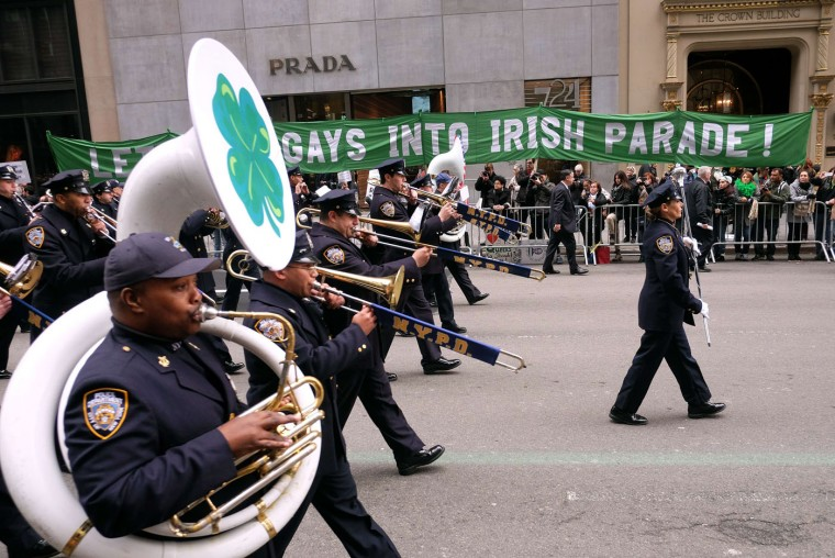The New York City Police Department band marches past a group of protesters during the St Patrick's Day parade in New York on March 17, 2015. The group was protesting the exclusion of Gay groups from the parade. (Jewel Samad/AFP/Getty Images)
