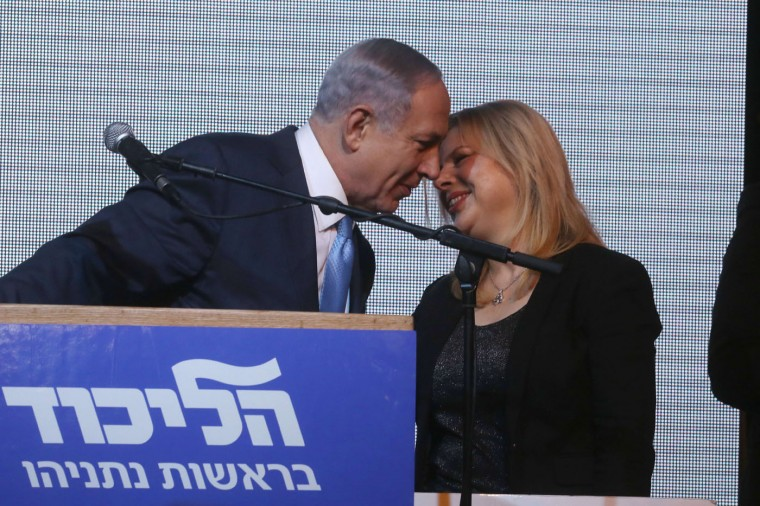 Israeli Prime Minister Benjamin Netanyahu kisses his wife Sara after exit poll figures in Israel's parliamentary elections late on March 17, 2015 in the city of Tel Aviv. Netanyahu claimed victory in elections as exit polls put him neck-and-neck with centre-left rivals after a late fightback in his bid for a third straight term. (Menahem Kahana/AFP/Getty Images)