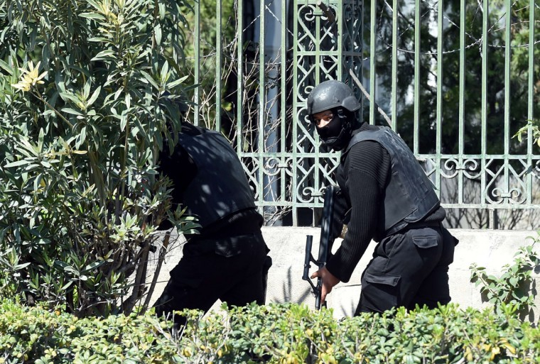 Tunisian security forces secure the area after gunmen attacked Tunis' famed Bardo Museum on March 18, 2015. At least seven foreigners and a Tunisian were killed in an attack by two men armed with assault rifles on the museum, the interior ministry said. (AFP Photo/Fethi Belaid)
