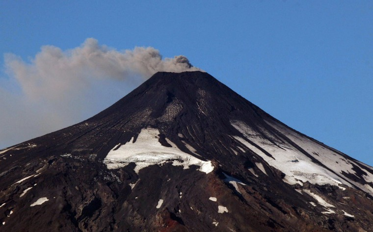 The Villarrica volcano, in the 9th region of La Auracania in southern Chile, shows visible signs of activity on March 18, 2015 prompting authorities to declare an orange alert. Earlier this month, in its first major eruption in 15 years, the Villarrica forced the evacuation of thousands of people amid a shower of fire and ash. (Sebastian Escobar/AFP/Getty Images)