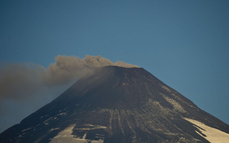 Smoke billows from the Villarrica volcano, as seen from Pucon, in the 9th region of La Auracania in southern Chile, on March 19, 2015. Earlier this month, in its first major eruption in 15 years, the Villarrica forced the evacuation of thousands of people amid a shower of fire and ash. (Martin Bernetti/AFP/Getty Images)