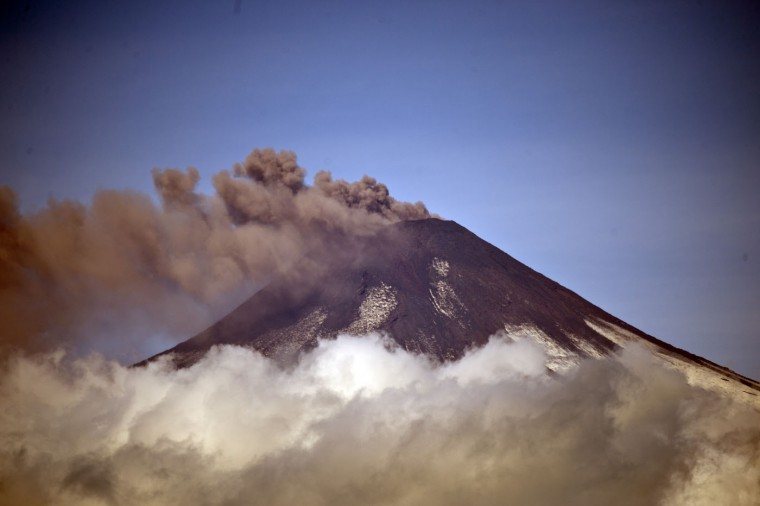 Picture of the Villarrica volcano taken on March 20, 2015 from Pucon, in southern Chile, as it shows renewed activity two weeks after its eruption. Earlier this month, in its first major eruption in 15 years, the Villarrica forced the evacuation of thousands of people amid a shower of fire and ash. (Martin Bernetti/AFP/Getty Images)