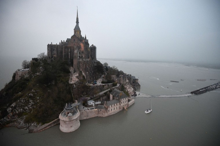 "An aerial view of Mont-Saint-Michel surrounded by the sea during high tide on March 20, 2015. A ""supertide"" is expected on March 21 that will affect coastlines around the North Sea, the English Channel and to a lesser extent in the Mediterranean. The world-famous Mont Saint-Michel on France's northern coast is braced for an especially big tide, with a difference between high and low tide of 14.15 meters. (Damien Meyer/AFP-Getty Images)"