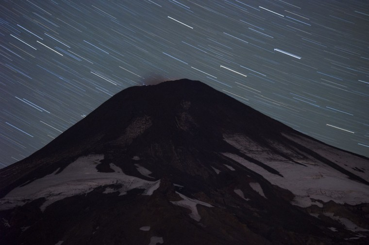 Night view of the Villarrica volcano from Pucon, some 800 km south of Santiago, on March 20, 2015. Earlier this month, in its first major eruption in 15 years, the Villarrica forced the evacuation of thousands of people amid a shower of fire and ash. (Martin Bernetti/AFP/Getty Images)