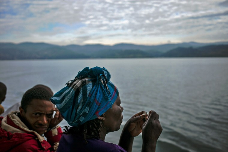 A woman eats seeds on the ferry as it leaves Bukavu for Goma on March 26, 2015. (AFP Photo/P /federico )